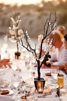 Add crystals to branches for an elegant, whimsical, fall inspired table setting.
