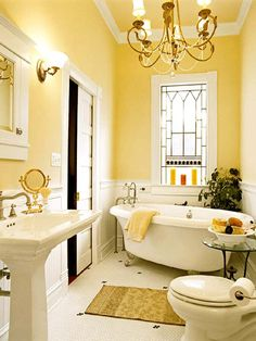 yellow bathroom interior- This is to die for....the lighting is amazing!