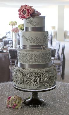 Elegant and sophisticated cake with grey and silver detail.  The pink flower on the top sets off the silver very nicely.  ᘡղbᘠ