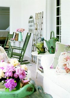 I enjoy the antique design and floral touches on this porch.