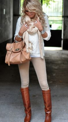 White cable knit sweater, tan legging pants, brown boots, tan scarf, and tan satchel.