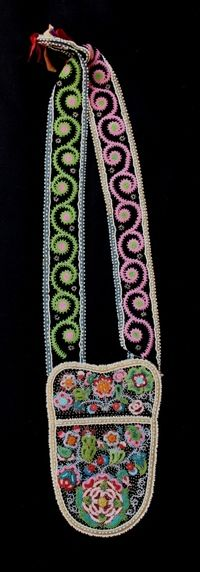 "Cree Bandolier Bag  19th Century  A very fine Cree Bandolier bag in beautiful condition. Classic Cree beadwork.    Measures: 29"" x 6 ¼"""