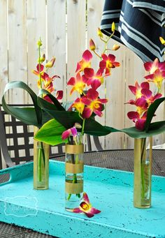 DIY- Striped bud vases.  Learn how Christina used ScotchBlue to create this elegant look