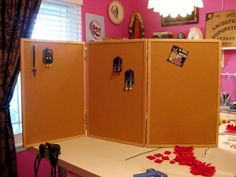 hinge cork boards together for displaying craft fair items