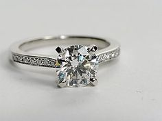 Elegant in every way, this diamond ring is crafted in platinum micropavé-set diamonds and milgrain edges to frame your choice of center diamond. Setting includes 1/6 carat total diamond weight.  #bluenile