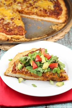 Easy Tostada Pizza is a fun cross between a taco, pizza and a tostada! Yummy, quick & easy dinner for any night of the week!