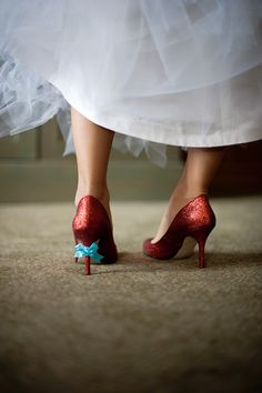 Something blue: blue bows tied to her heels... cute