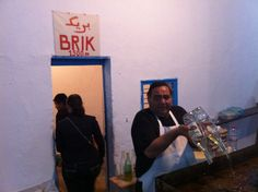 A cook in the synagogue's social space adds oil for cooking brik, a traditional Tunisian fast-food item deep-fried with eggs, chili paste and tuna. The Jewish variety is often flavoured with saffron mint, differentiating it from the usual type.