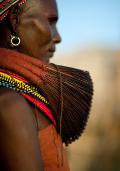 Africa   Details; Married Rendille woman with Mpooro Engorio necklace.  Kenya   ©Eric Lafforgue
