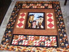 Special order quilt using applique pattern of horses by Bigfork Bay and desiging the rest of the quilt around it.