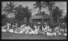 Women and men dressed in white sitting on grass, two government officials stand in the back. Creator/Contributor: Lambert, Sylvester Maxwell, 1882-1947, Photographer Date:between 1919 and 1939 Contributing Institution: UC San Diego, Mandeville Special Collections Library