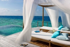 A villa floating over the ocean in the Maldives - sounds like paradise!