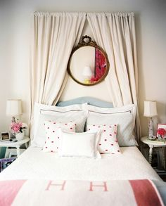 How cute are the mirror and curtains over the bed?