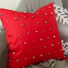 Decorate for Christmas with a decorative throw pillow that actually jingles! This DIY holiday throw pillow will look fun and festive in your living room. #thecraftyblogstalker #christmascrafts #throwpillows #christmasdecor #jinglebells