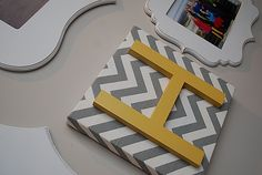 Letter over chevron fabric covered canvas.