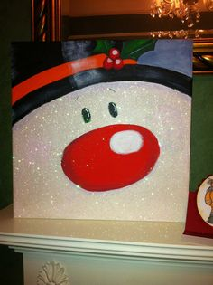 cute idea ??? paint a snowman on a board or canvas as Christmas decoration ??? and, don't forget the sparkles ??????