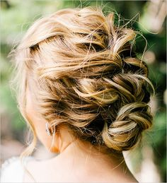 Braids are in! Find wedding day braid ideas here.