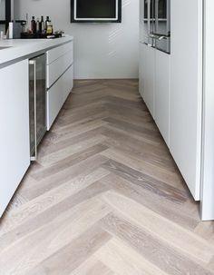 Wood look tile set in a chevron pattern