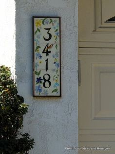 This sweet tiled house number adds so much curb appeal! Front-Porch-Ideas-and-More.com #porch
