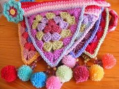 Another wonderful crocheted bunting, this one with pompoms and beads to decorate it!