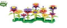 """Green Toys Build-a-Bouquet - perfect gift for a 2-year-old girl or boy who likes to help with gardening. Our little guy uses the set to build super-tall """"flower beanstalks."""""""
