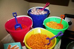 Colorful buckets and shovels serve up the party snacks for a summer BBQ or kids' birthday party!