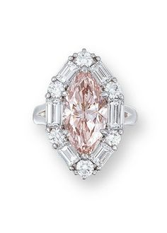 Marquise-cut pink diamond weighing 5.00 carats, within a brilliant and baguette-cut diamond surround, mounted in platinum.