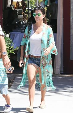 Turning Japanese: Kourtney Kardashian wears a green floral kimono with matching aviator sunglasses