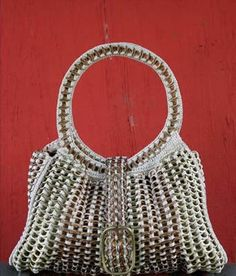 Hand made with soda can tabs. Very cool.