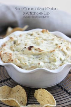 Cheesy artichoke dip with beer caramelized onions, cream cheese, parmesan cheese and green onions.
