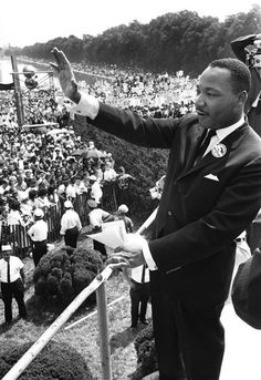 US civil rights leader Martin Luther King Jr waves to supporters in 1963 from the Lincoln Memorial on the Mall in Washington DC.