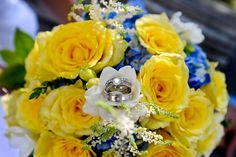 A beautiful shot of the wedding rings in the middle of the bride's bouquet. Karenscape Photography.