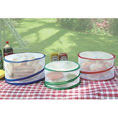 Pop-up Food Covers (set of 3) Portable mesh covers store flat when not in use, yet open fully at a flick of a wrist. They'll stay put on a breezy day, yet will lift off instantly for easy access to food.  $14.98