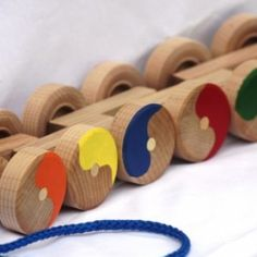 Toy Stack and Roll Pull Toy with 12 Wheels in 6 Colors - American made toys for kids - childrens toys that are made in America - Christmas toys - vintage children's toys - a handcrafted stack and roll pull toy. http://aftcra.com/mccoytoys/listing/3762/toy-stack-and-roll-pull-toy-with-12-wheels-in-6-colors