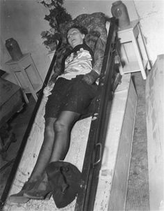"""The corpse of a woman lies in an open coffin at the Hadamar Institute where she was put to death as part of the Operation T4 euthanasia program."""
