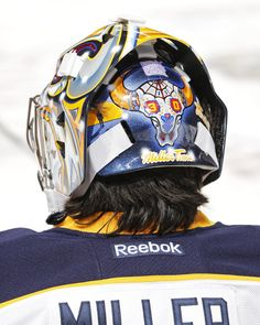 A detailed view of the rear of the mask of goaltender Ryan Miller of the Buffalo Sabres displaying a sticker for #HockeyFightsCancer.