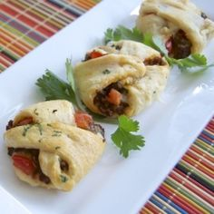 Taco Pockets - Crescent rolls filled with taco seasoned beef, pepper jack cheese, tomatoes, and cilantro ~ a great Game Day food!