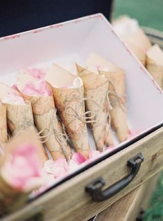 Scrapbook Paper Cones for Rose Petal Toss -- see more of the wedding here: http://www.StyleMePretty.com/2014/05/14/vintage-wedding-that-fully-embrace-the-pastel-color-trend/ Photography: ByronLovesFawn.com