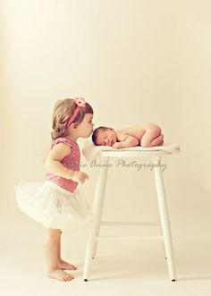 Newborn photo with big sister or brother. Could use chair Or stool