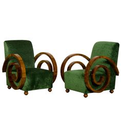 A pair of Art Decó period walnut armchairs from France ~ 1930