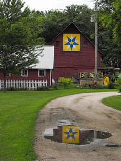 Barn quilt with reflection.