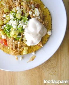 Easy Crockpot Chicken Tostadas - so you don't have to turn on the oven on these hot days to come but still have an amazingly tasty meal!
