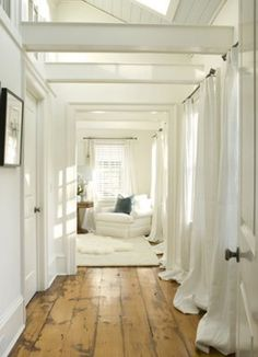 gorgeous hardwoods, curtains lining the hallway