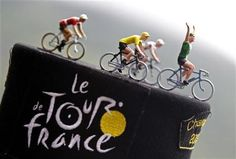 Toys figurines representing the leaders jersey riders are seen on a hat before the start of the 17th stage of the 99th Tour de France cycling race between Bagneres-de-Luchon and Peyragudes, July 19, 2012. REUTERS/Bogdan Cristel/Files