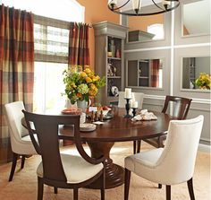 Make your dining room -- or any room -- feel larger and brighter by decorating entire walls with framed mirrors and inexpensive mouldings.
