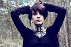 stretched ears and vertebrae tattoo