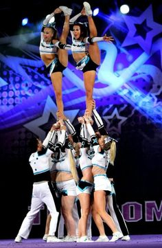 CHEER bow and arrow stunt competitive cheerleaders in competition from Kythoni's Cheerleading: Stunts board http://pinterest.com/kythoni/cheerleading-stunts-bow-arrow-heel-stretch-scorpio/ #KyFun m.16.55.1