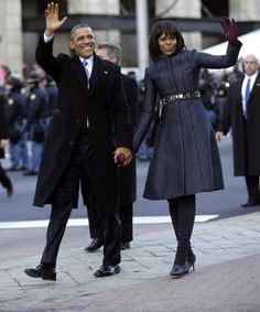President Barack Obama and First Lady Michelle Obama step out of the presidential limo and walk in the inaugural parade.