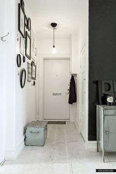 I'd paint the door and/or the facing wall too, but still the line made by the black wall is nice.