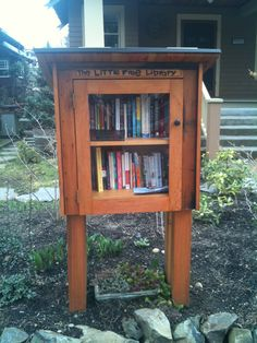 Free library in front of NE Portland house. I would love to do something like this. On the inside it says take a book now, leave a book later.